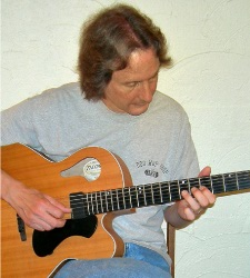 George Seccombe of Alpine Music Studios Playing Guitar